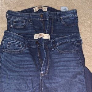two pair of hollister jeans